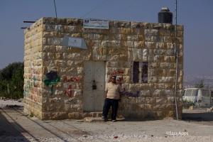 Amjad outside the village school