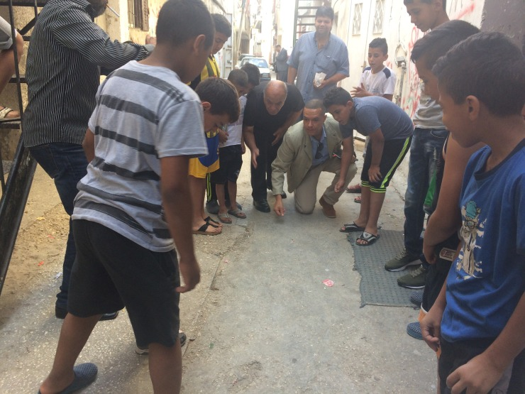 Clive Lewis MP playing with children in Al Am'ari refugee camp
